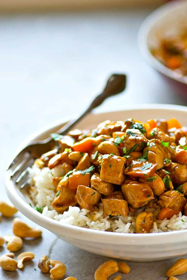 This flavorful twist on classic cashew chicken stir-fry features tons of sweet peppers and fresh ginger in a rich sauce. Pile it all over a mound of rice for a dinner WAY better than take-out!