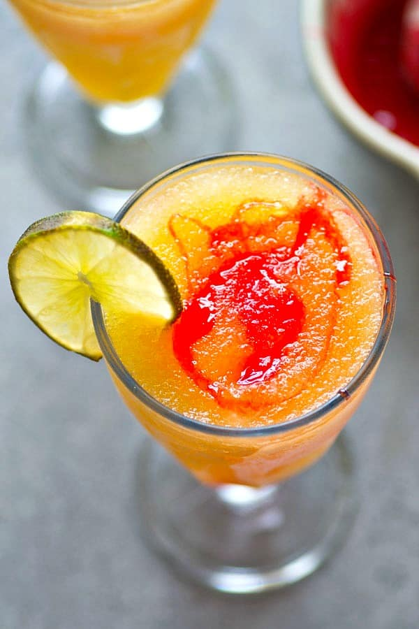 These tequila sunrise slushies are a frozen twist off of the classic cocktail and they're SO easy to blend up! Make a double batch because these sippers are gonna disappear fast.