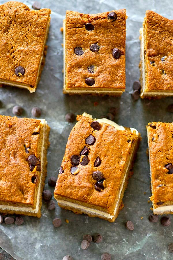 A thick layer of creamy vanilla ice cream is sandwiched between soft homemade chocolate chip blondies for the ultimate twist on ice cream sandwich bars!
