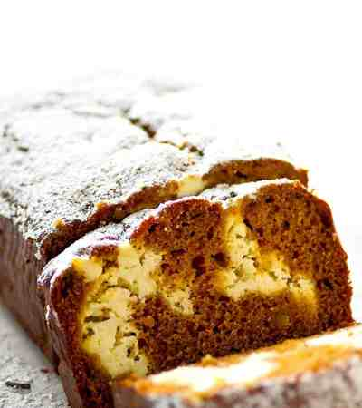Soft, spiced gingerbread is filled with a luscious cheesecake swirl for the ultimate twist on gingerbread! This gingerbread cheesecake swirl quick bread is a holiday brunch must.