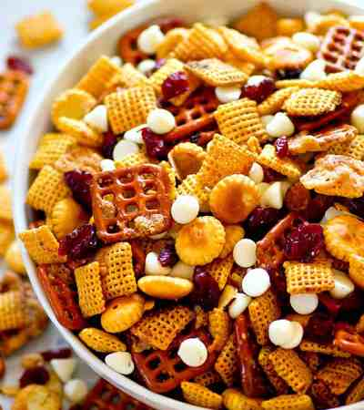 Sweet 'n' salty flavors pair with cranberries and white chocolate in this ADDICTING cranberry bliss snack mix! Make a big batch because it'll go fast!