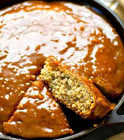 Incredibly soft banana bread snack cake is drizzled with a spiced chai caramel glaze for a simple, no-fuss snack, dessert, or even breakfast!