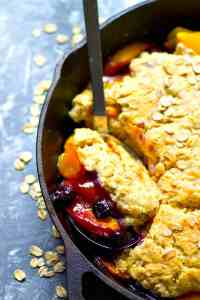 Dessert for breakfast IS a thing when you throw together this totally summery breakfast peach blueberry oatmeal cobbler! Serve it piping hot with big piles of vanilla yogurt.