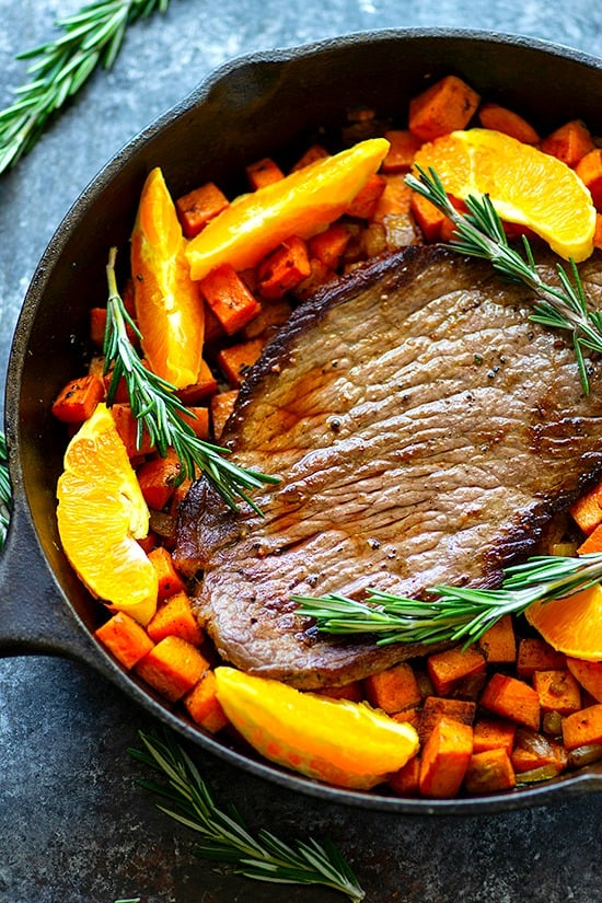One-Pan Orange Rosemary Steak and Sweet Potatoes - Juicy oranges and fragrant rosemary join forces in this weeknight-friendly one-pan orange rosemary steak roasted with tender sweet potatoes in an incredible orange rosemary sauce!