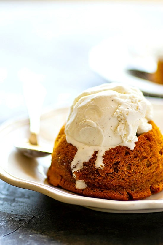 Salted Caramel Chai Pumpkin Lava Cakes - Cozy chai spices and warm salted caramel take these pumpkin lava cakes completely over the top! Serve them warm with a big scoop of vanilla ice cream and welcome to fall heaven.