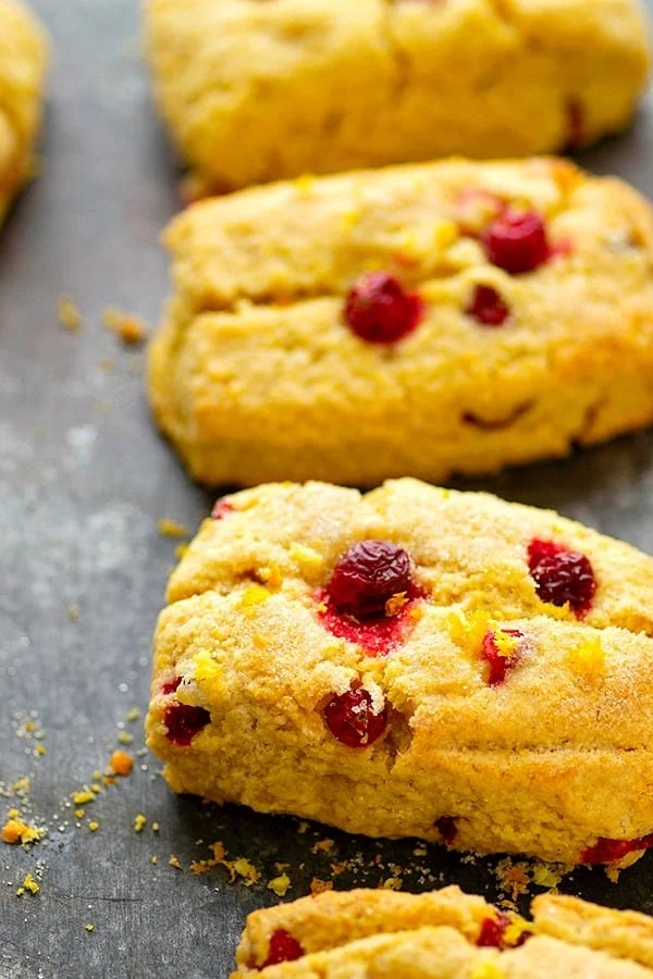 Cranberry Cornmeal Orange Scones - Tangy cranberries and tons of orange flavor take these rustic cranberry scones to the next level! Easy to make for holiday brunch and SO pretty on a brunch table!