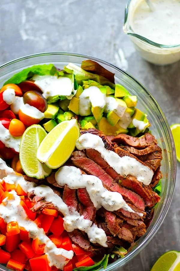 Carne Asada Steak Salad Bowls - A zingy jalapeno lime steak marinade makes for the most FLAVORFUL carne asada steak salad bowls! Serve this loaded steak salad with all the salad fixins' and creamy bleu cheese dressing.