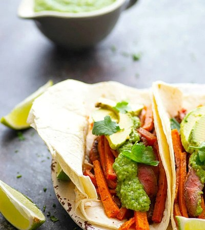 Jerk Sweet Potato Steak Tacos - Jerk-rubbed steak and roast sweet potatoes are piled into soft flour tortillas and topped with a creamy avocado salsa verde for an incredible twist on sweet potato steak tacos!