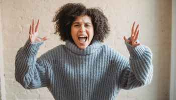 angry black woman screaming in room