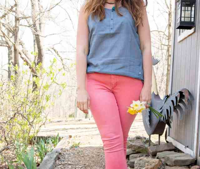 Full Body Shot Of A Woman In A Blue Shirt And Pink Pants Holding A