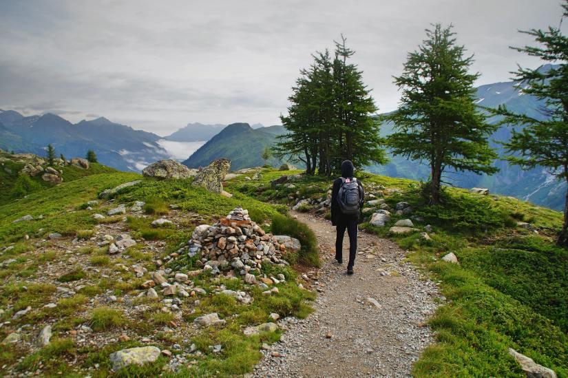 walking toward your goals: man walking up the mountainside
