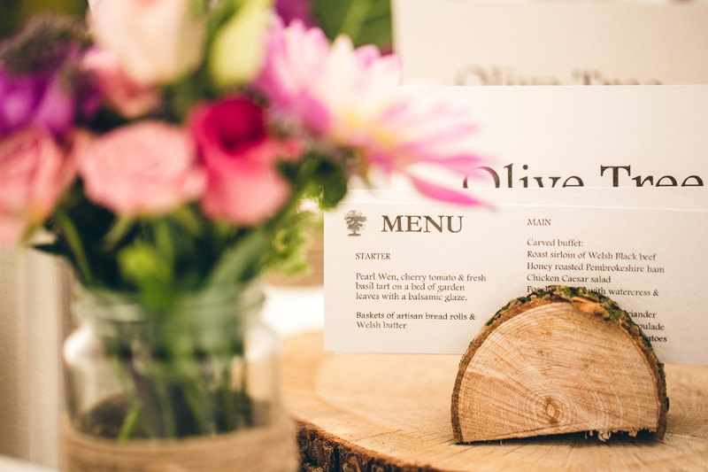 Woodblock table decorations. At home Pembrokeshire wedding by Whole Picture Weddings