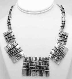 Silver necklace.