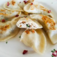 Dumplings with herbed chanterelles, goat's cheese and chicken