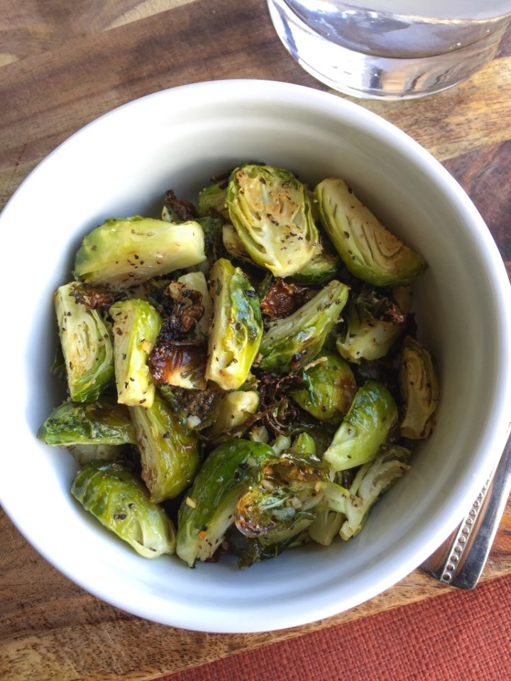 Paleo, Whole30, And keto friendly Garlic roasted Brussels sprouts. Www.wholesome-joy.com