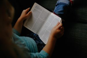 Image of woman reading her Bible