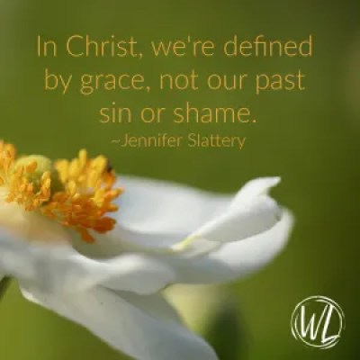Defined by grace on an image with a white flower