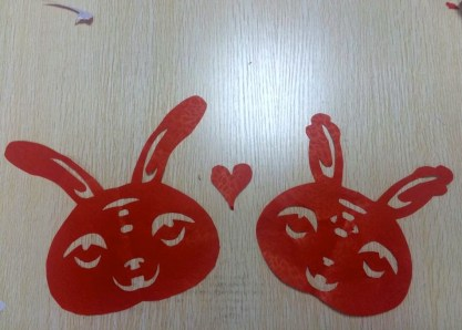 Paper cutting. The Rabbit and the Rat = Love.