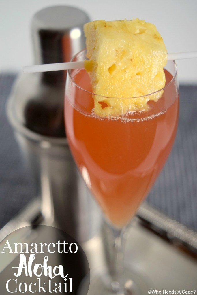 The Amaretto Aloha Cocktail sweeps you away to the tropics! A simple beverage to make, make a pitcher for your next party!