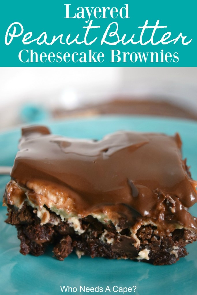 brownie on blue plate with layer of cheesecake and frosting