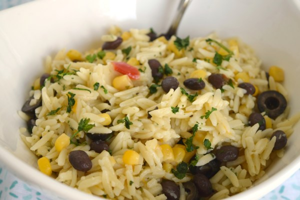 Fiesta Orzo Salad is a great dish to serve alongside a variety of foods. With black beans, corn and seasonings its full of flavor!