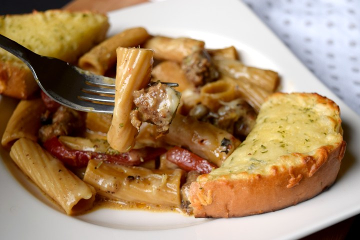 Rigatoni & Italian Sausage Skillet Meal is a hearty one pan dish that's easy enough for weeknights. Loaded with flavor you'll love this simple dish.