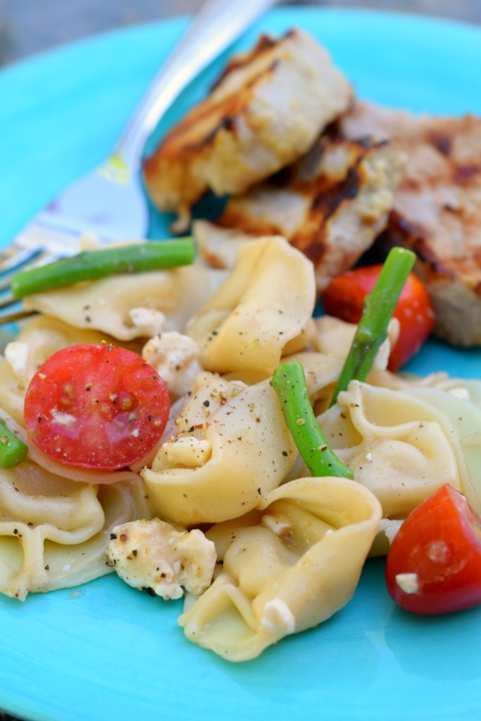 A taste of summer is what Asparagus Tortellini Pasta Salad brings to table. Loaded with deliciousness this side dish is ideal for grilling or parties.