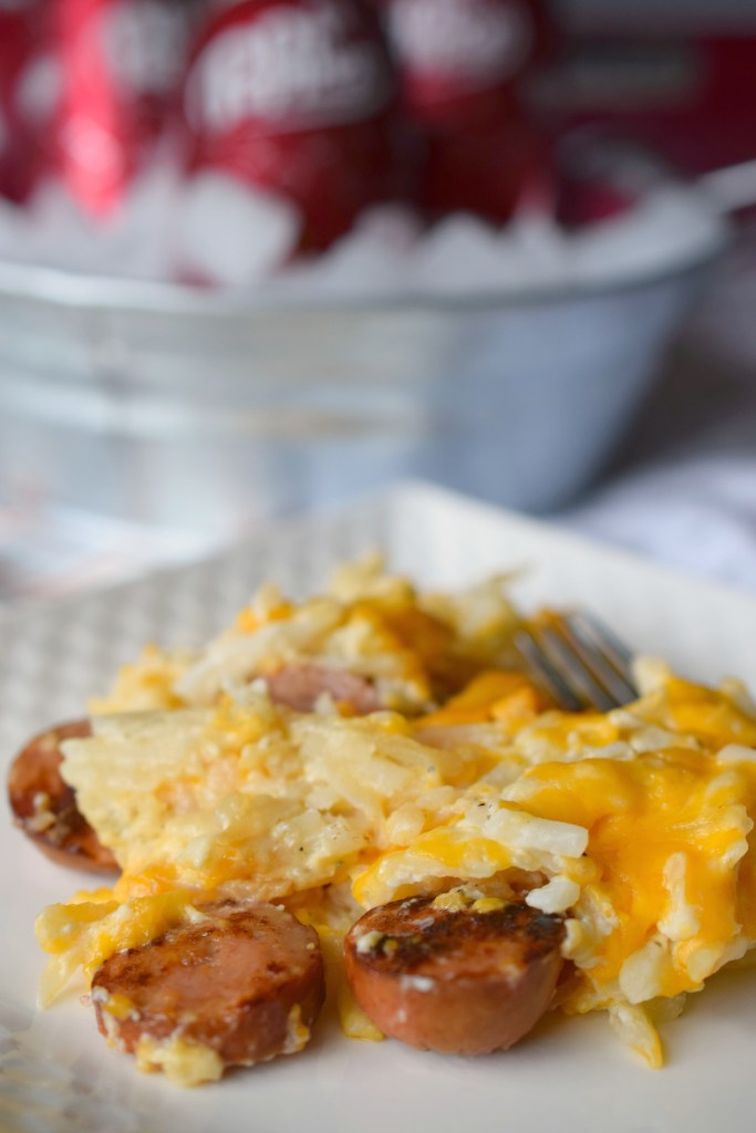 A delicious casserole made in your crockpot? Yes, please! Slow Cooker Smoked Sausage Cheesy Potatoes is a hearty & delicious meal perfect for parties!
