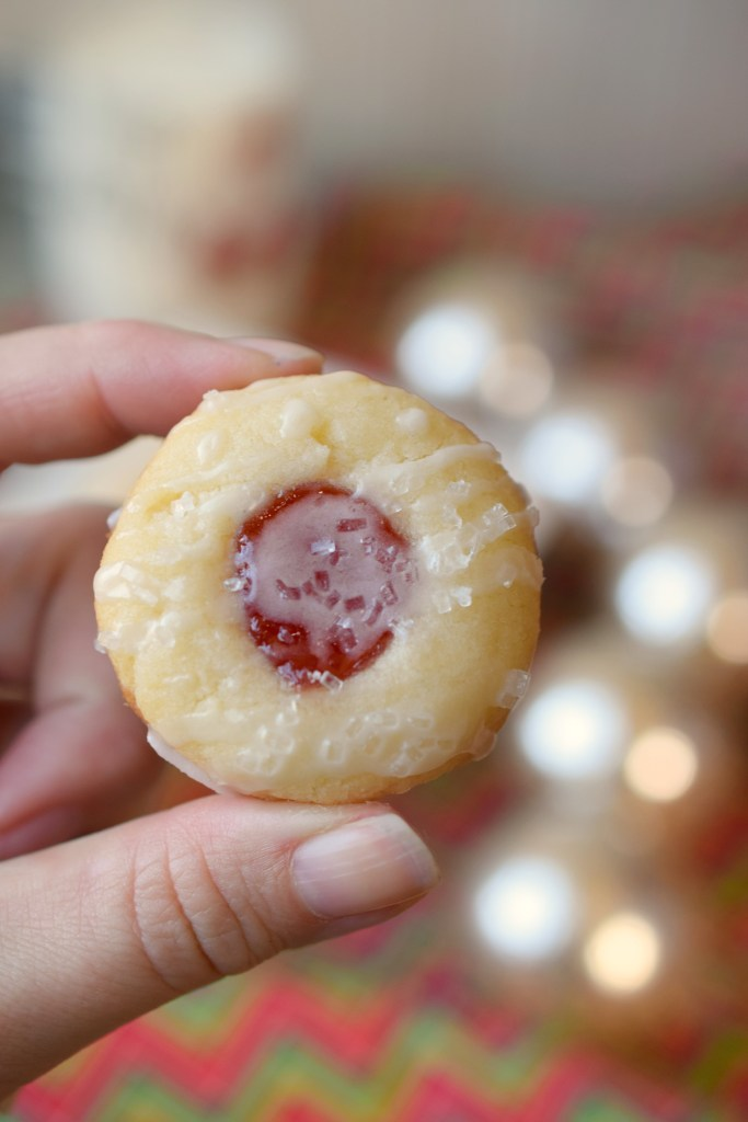 Almond Raspberry Thumbprint Cookies are the perfect addition to holiday cookie trays. Easy to make, full of flavor and perfect with a glass of milk.