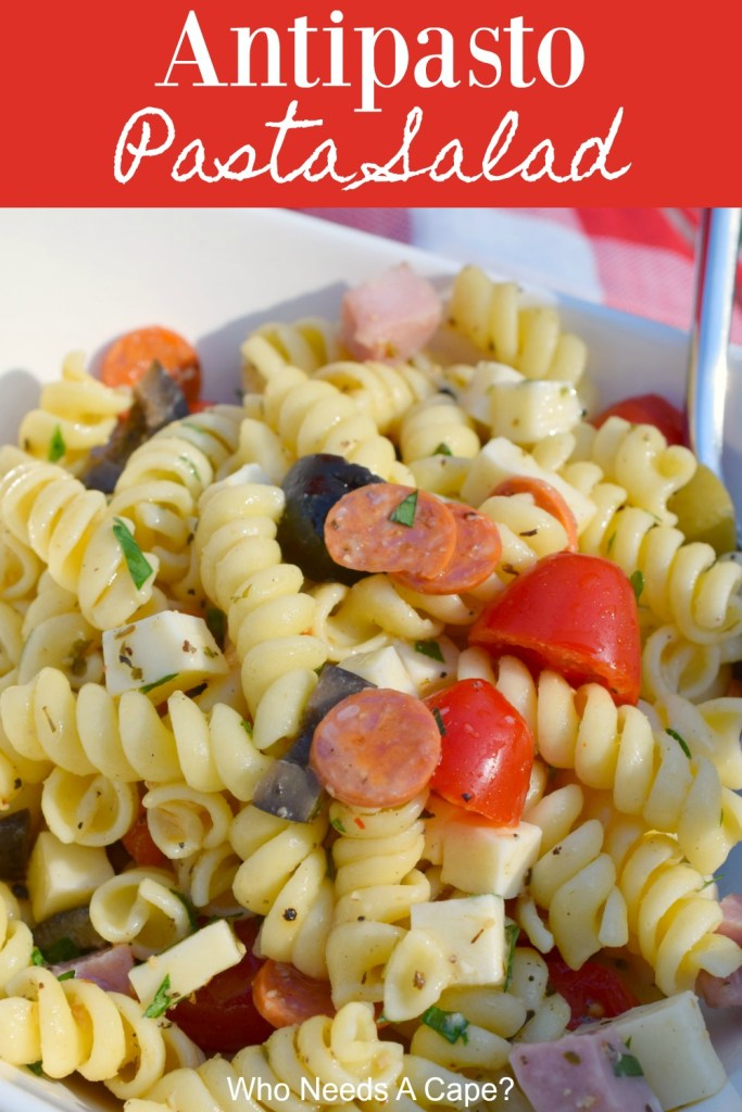 pasta salad in white bowl with spoon