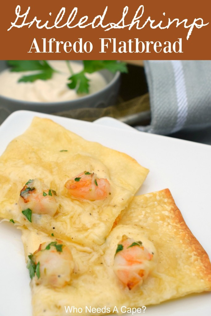 Two pieces of grilled shrimp alfredo flatbread on white plate next to dip