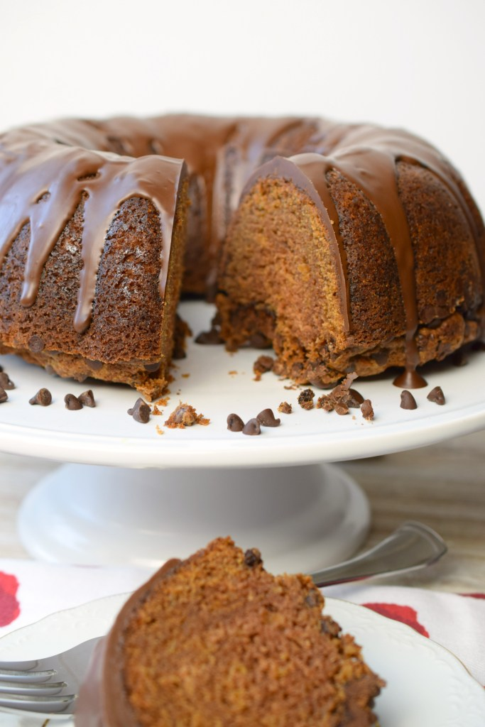 Glazed Chocolate Chip Apple Cake, the perfect addition to fall parties. A delicious spiced cake with a hint of chocolate & fresh apple, topped with a glaze.