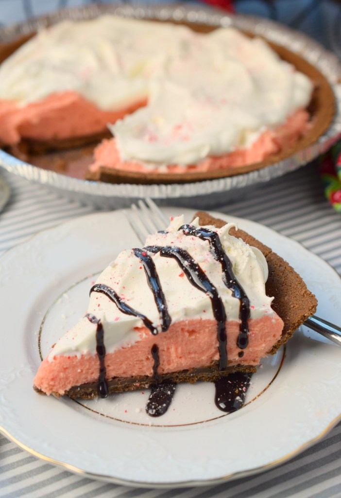 No Bake Peppermint Eggnog Pie combines two traditional holiday flavors in an easy recipe. You'll love the flavors in this simple dessert.