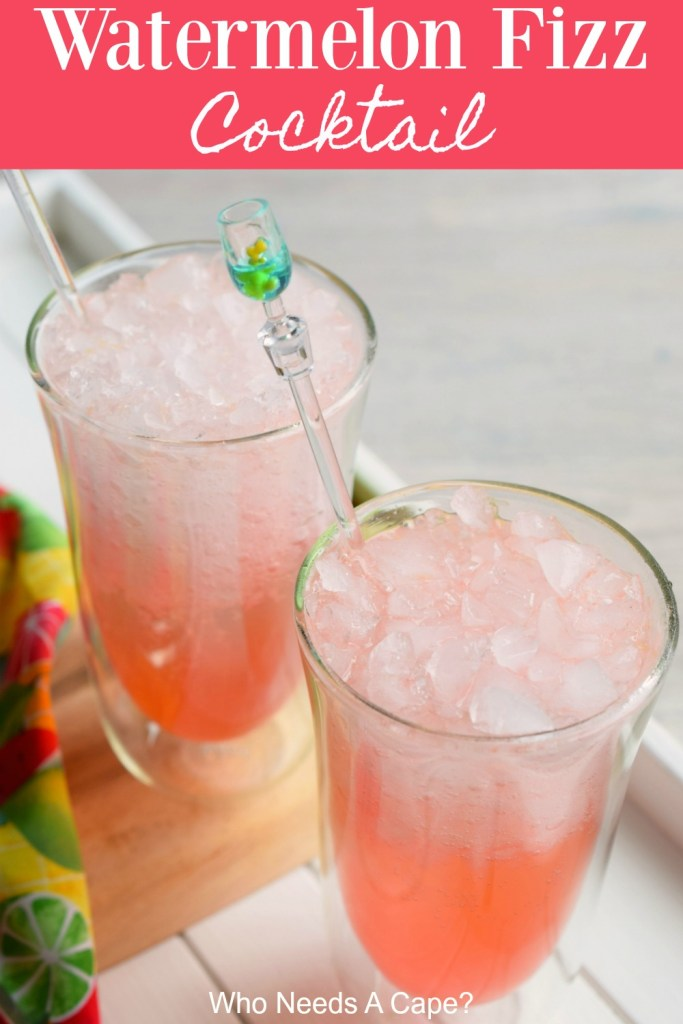 watermelon fizz cocktail in glasses with cocktail stirrers on wood board next to bright colored fabric