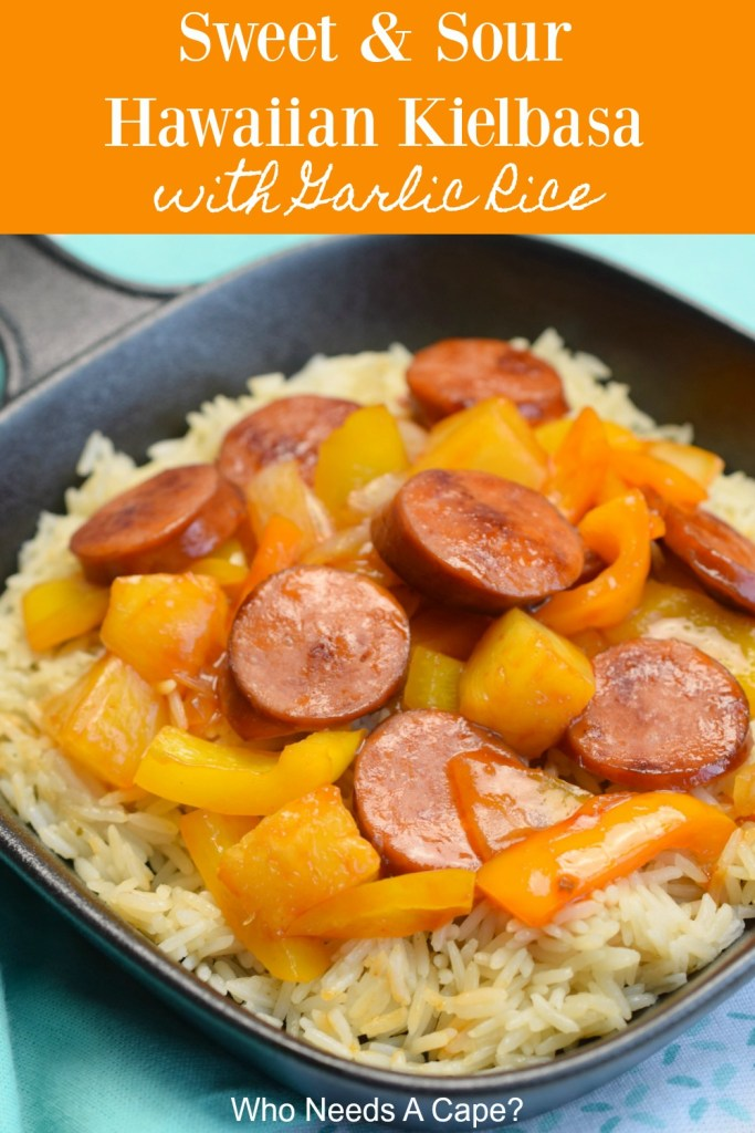 black pan holding rice and kielbasa pieces with bell peppers, onions and pineapple