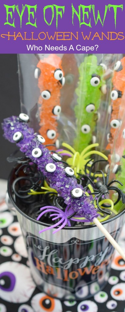 rock candy stick with candy eyeballs ready as party favors in bucket with plastic spider rings