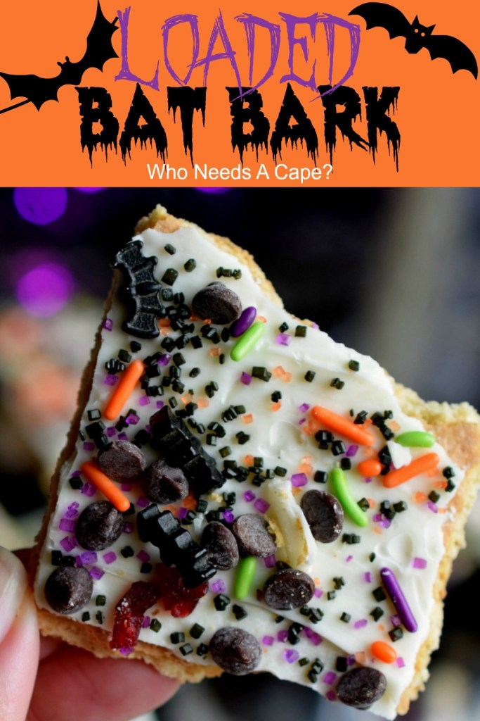 piece of loaded bat bark with white chocolate on graham cracker with assorted sprinkles