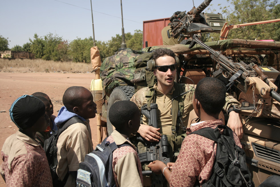 A French soldier explains to Vietnamese (er, Malian) children why he thinks he is in their country