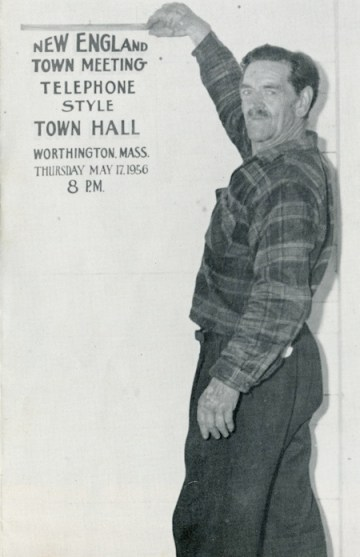 "Emmy Davis photographed in... The caption read, ""Assistance of Town Hall custodian Emerson Davis ran the gamut from tacking up posters, setting up tables and chairs to buttonholing townspeople and urging them to attend the Meeting!"""