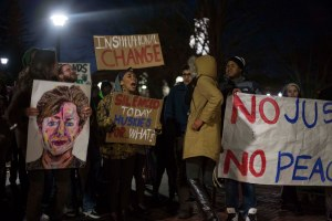 Students rally outside of UConn President Susan Herbst's office in Gully Hall Tuesday evening.