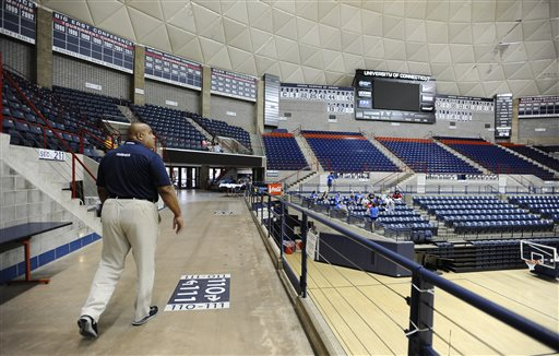 Former University of Connecticut athletic director Warde Manuel walks through Gampel Pavilion (AP Photo/Jessica Hill)