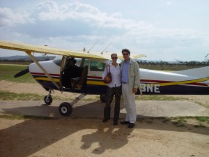 Susan and virtualDavis boarding a bush plane in Africa
