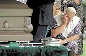 Bryan Lee Curtis' mother Louise Curtis grieving at his grave site