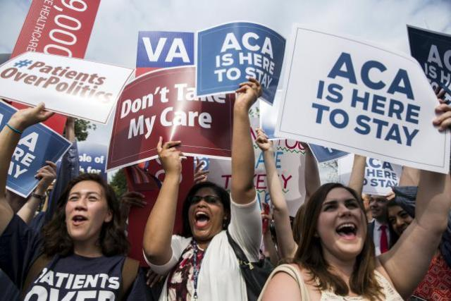 Supporters of the Affordable Care Act celebrate after the Supreme Court up held the law in the 6-3 vote at the Supreme Court in Washington June 25, 2015. The U.S. Supreme Court on Thursday upheld the nationwide availability of tax subsidies that are crucial to the implementation of President Barack Obama's signature healthcare law, handing a major victory to the president.  REUTERS/Joshua Roberts