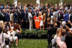 U.S. President Barack Obama (C) is presented a jersey with his name on it as he welcomes the NFL's Denver Broncos for a reception in honor of their Super Bowl football championship, in the Rose Garden of the White House in Washington, U.S., June 6, 2016. REUTERS/Jonathan Ernst