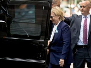 "Democratic presidential candidate Hillary Clinton gets into a van as she departs an apartment building Sunday, Sept. 11, 2016, in New York. Clinton's campaign said the Democratic presidential nominee left the 9/11 anniversary ceremony in New York early after feeling ""overheated."" (Photo: Andrew Harnik, AP)"