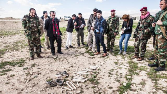 Father Patrick Desbois, second from left in foreground, visits the mass graves of Yazidis in Sinjar, Iraq. (Stephan Pramme)