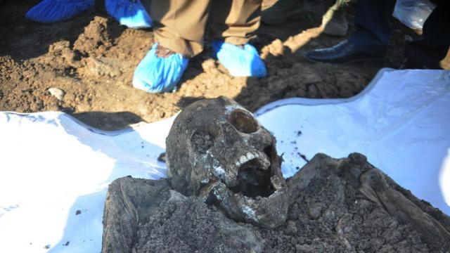 This file photo from 2015 shows a skeleton exhumed from a mass grave of Yazidis killed by Islamic State militants in the Sinjar region of northern Iraq. (Kurdish Mass Graves Directorate)