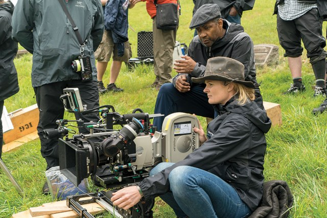 David Lee/Paramount Pictures Washington with cinematographer Charlotte Bruus Christensen on location in the Hill district of Pittsburgh, where playwright Wilson grew up.