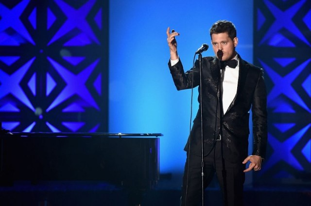 Michael Buble postpones his concert tour and puts his career on hiatus while his son, Noah, is in treatment. (Photo: Michael Loccisano/Getty Images)